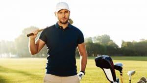 Handsome confident male golfer standing with golf club - polo Shirts - Workwear Toronto - WorkwearToronto.com